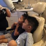 Two boys sitting at dental chair in Dunwoody, GA.