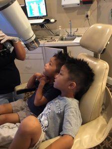 Two boys sitting at dental chair in Dunwoody, GA.