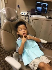 Young boy is showing his lower teeths. Dunwoody, GA.