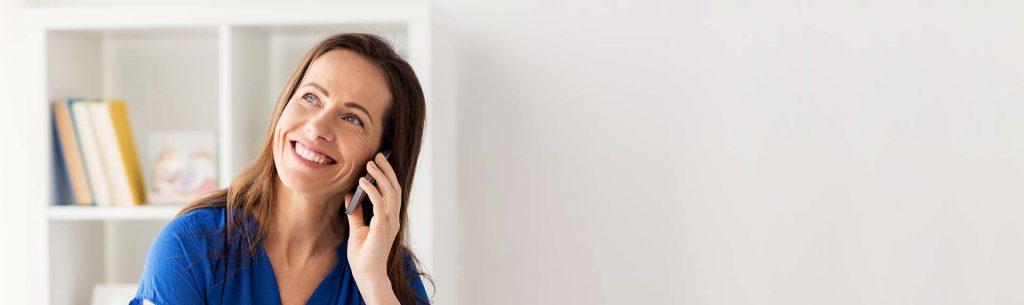 smiling woman talking on the phone dunwoody, ga