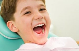 Child in Dentist Chair Smiling Dunwoody GA