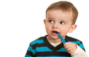 Child with a Toothbrush in His Mouth
